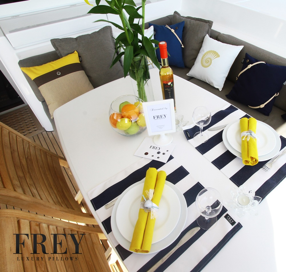 yellow pillows on yacht decoration